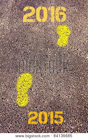 Yellow Footsteps On Sidewalk From Year 2015  To Year 2016 Messages.new Years Concept Image