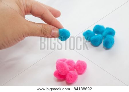Hand Grabing One Of Blue Set