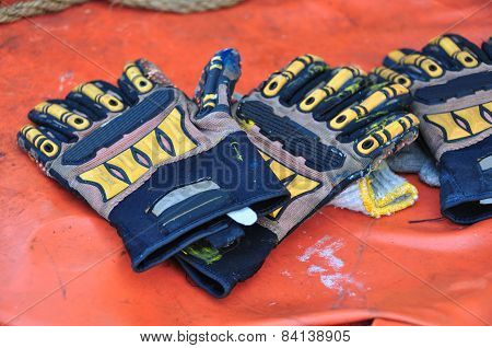 Old or dirty safety gloves on the works.