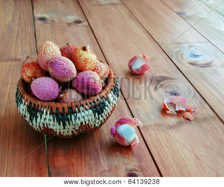 few litchi fruit in a wicker basket