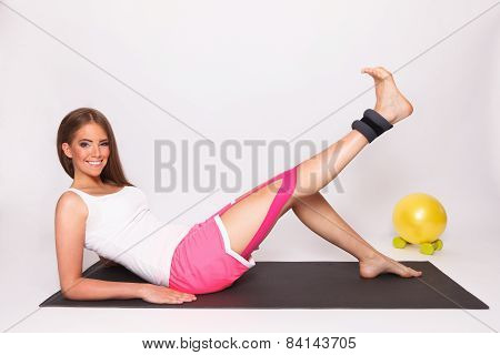 Woman Exercise With Taped Injured Leg