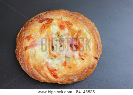 Pizza With Ham, Cheese And  On Black  Background.