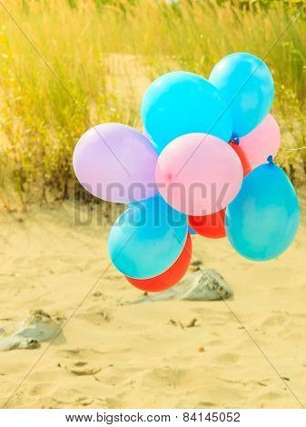 Balloon Chain On Sand Dune Beach