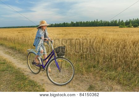 Teenager Boy Enjoys Cycling On Country Road