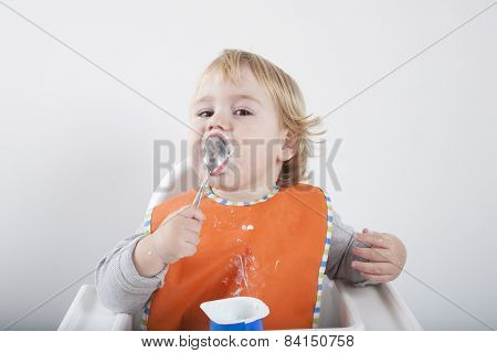 Baby Licking Spoon