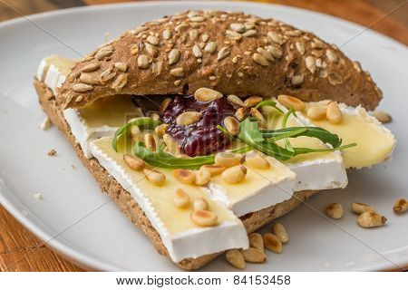 Brown Bread With Brie, Marmalade And Pine Nuts