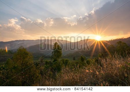Natural Sun Sets Behind The Mountains