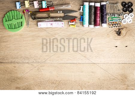 Sewing Tools Equipment Space For Sample Text Wood Background
