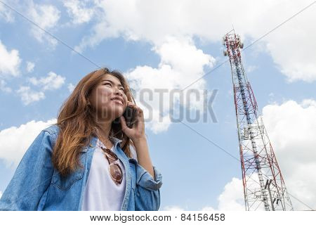 Beauty Women Use Smart Phone Call And Satellite Communication Tower Background