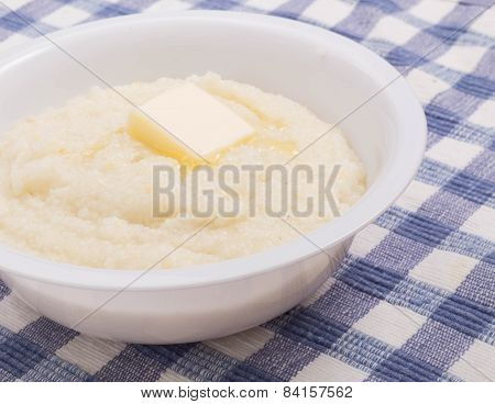 Pat Of Butter On Bowl Of Grits Closeup