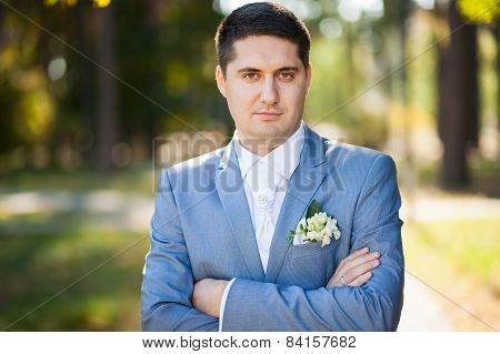 portrait of handsome young man smartly dressed in blue suit white shirt