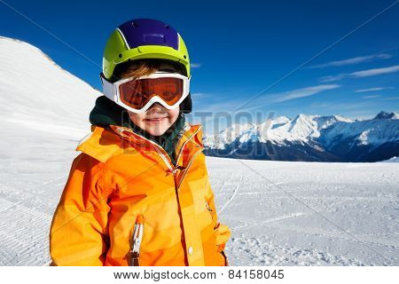 Close-up view of boy wearing ski mask on ski-track