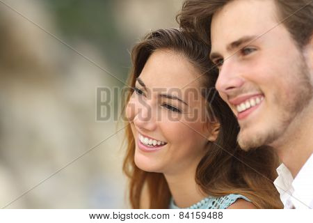 Happy Couple In Love Looking Away Together