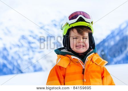 Portrait of small boy in ski mask and helmet
