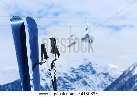 Mountain ski and poles with snow peak