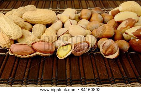 Nuts In Line-peanuts,walnuts,pistachios,brasil Nuts On Brown Mat