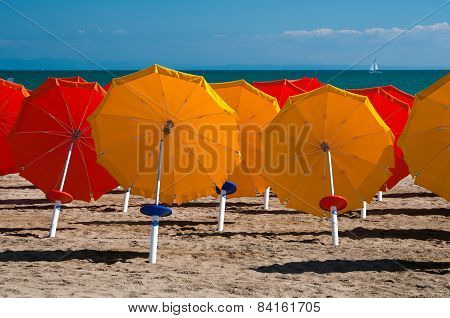 Umbrellas On Sandy Beach