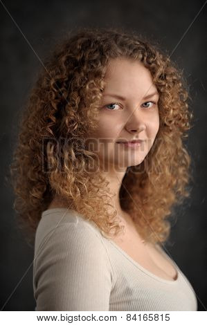 Smiling Fairy Woman With Red Curly Hair, Big Breast, Low Neck Decollete On Dark Grey Background
