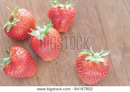 Fresh Strawberries On Wooden Table