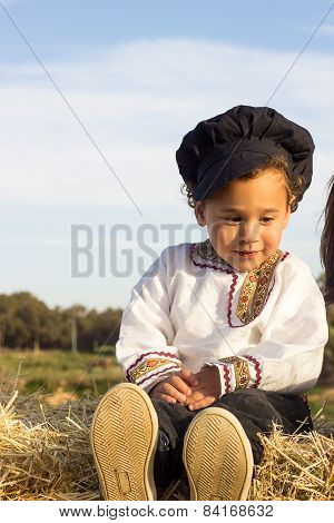 Child Playing In A Haystack.