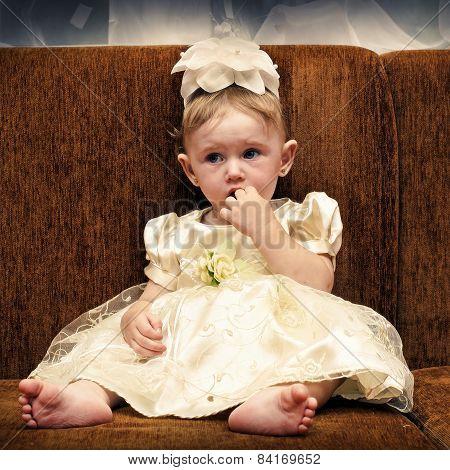 Sad Baby On Sofa