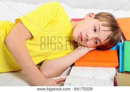 Tired Teenager With A Books