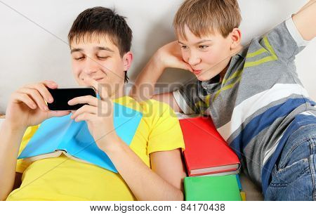 Brothers With A Books And Cellphone