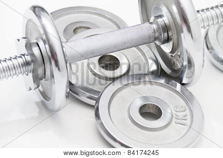 Black Dumbbells And Loose Weights