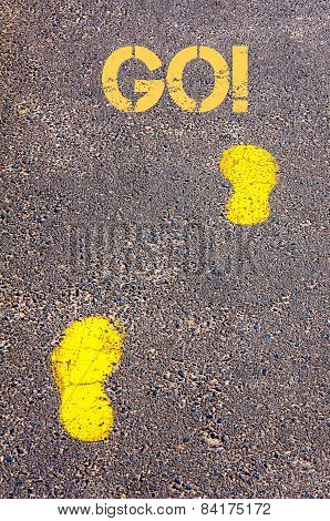 Yellow Footsteps On Sidewalk Towards Go Message