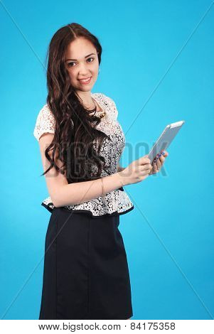 Portrait Of A Girl-teenager Holding A Tablet In His Hands