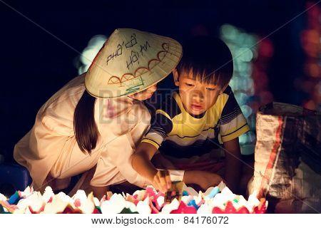 Vietnamese kids on the street of Hoi An, Vietnam