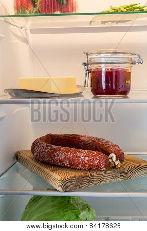 Open Fridge Stuffed With Salami And Foodstuffs