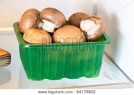 Mushrooms In The Fridge With The Door Open