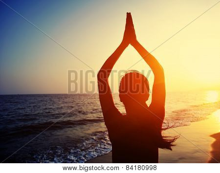 back of healthy yoga woman meditation at sunrise seaside