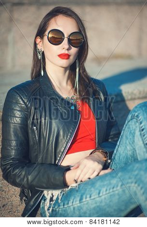 Young Fashion Hipster Beautiful Girl In Leather Jacket And Sunglasses