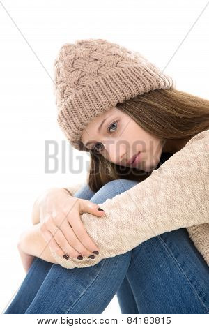 Sad Teenage Girl Sitting Embracing Her Knees