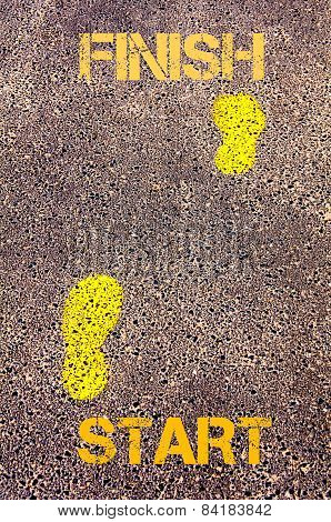 Yellow Footsteps On Sidewalk From Start To Finish Message. Concept Image