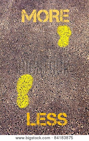 Yellow Footsteps On Sidewalk From Less To More Message. Concept Image