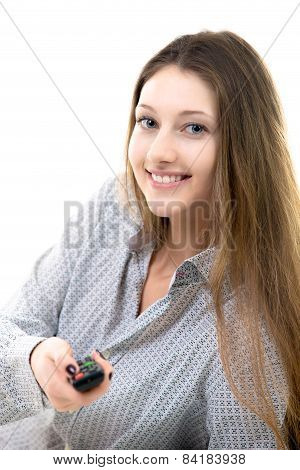 Smiling Teenage Girl Switching Channels On Tv