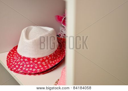 White and floral red hat
