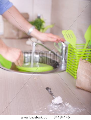 Washing Dishes After Kitchen Work
