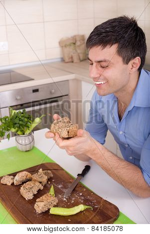 Man Eating Wholemeal Bread