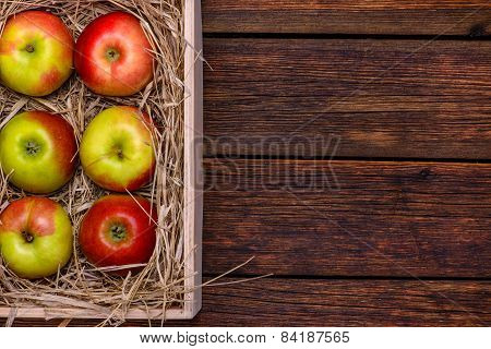 Fresh Apples In Box On Wooden Table With Copy Space