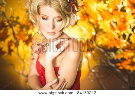 Magic gold autumn blonde girl portrait in leafs