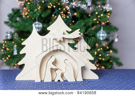 Light wooden christmas crib with Joseph and Mary