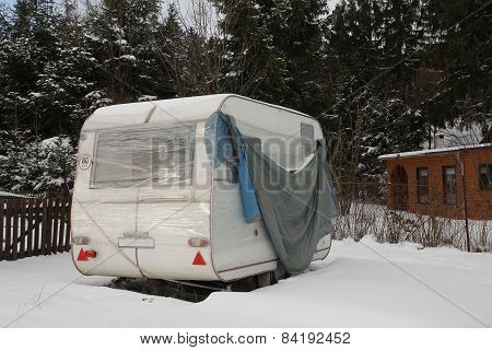 Camper Covered By  Snow In Winter