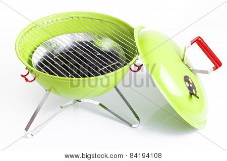 green kettle barbecue grill isolated on white background