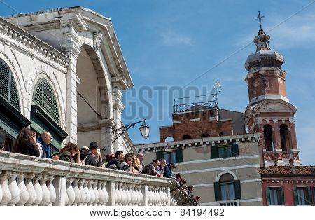 Tourists Talk To Each Other On The Rialto Bridge, Grand Canal