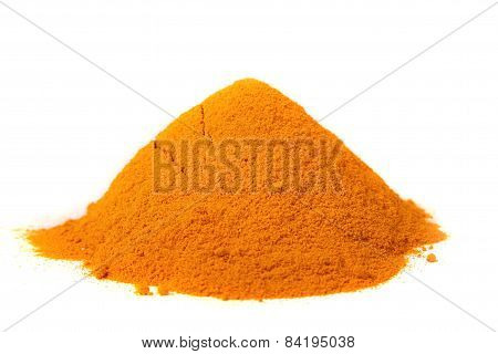 A Pile Of Turmeric On A White Background