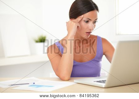 Elegant Young Woman Sitting And Surfing The Web